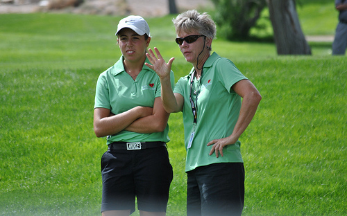 Washington Team Captain Patty Curtiss gives advice to team member Bree Wanderscheid.